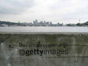 Graftiti on a wall at Gasworks Park mocks photo copyright giant